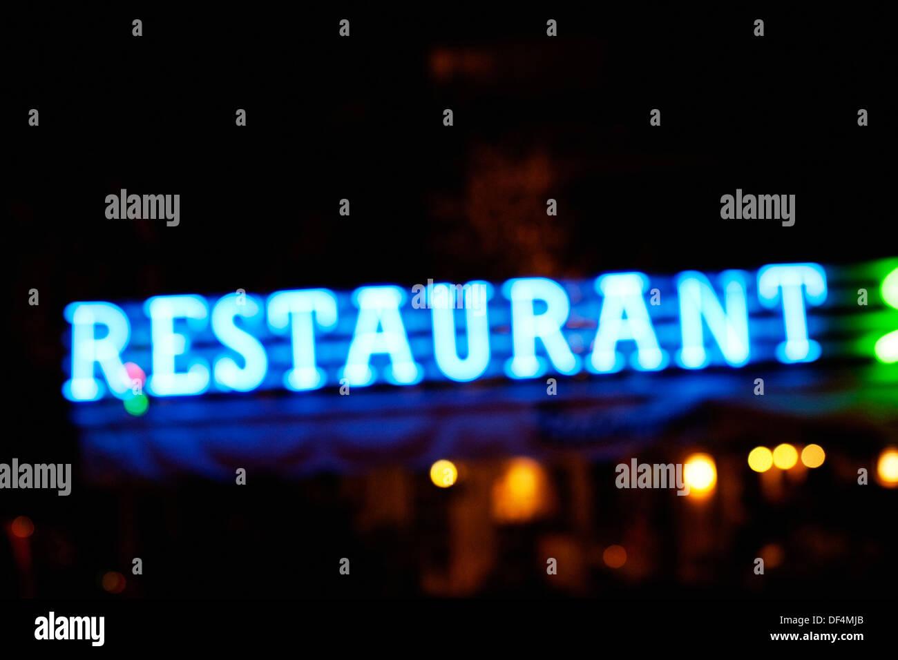 Illuminated Blue Restaurant Sign Stock Photo