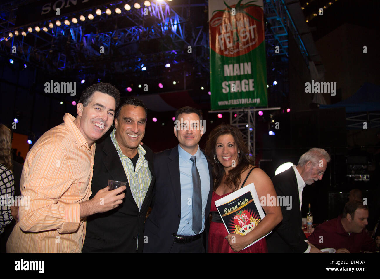 LA, CA, USA. 26th Sept, 2013. Comedian Adam Carolla, Doug DeLuca (Executive Producer, Jimmy Kimmel Live!), late night TV talk show host Jimmy Kimmel and Ann Potenza, Executive Director of the San Gennaro Foundation at the Prima Notte Gala at the Feast of San Gennaro Italian Festival in Los Angeles, CA, USA on September 26, 2013. The three men co-founded the Italian Feast of San Gennaro in Los Angeles with other notable Italian American leaders in LA in 2002. © Kayte Deioma/Alamy Live News - Stock Image