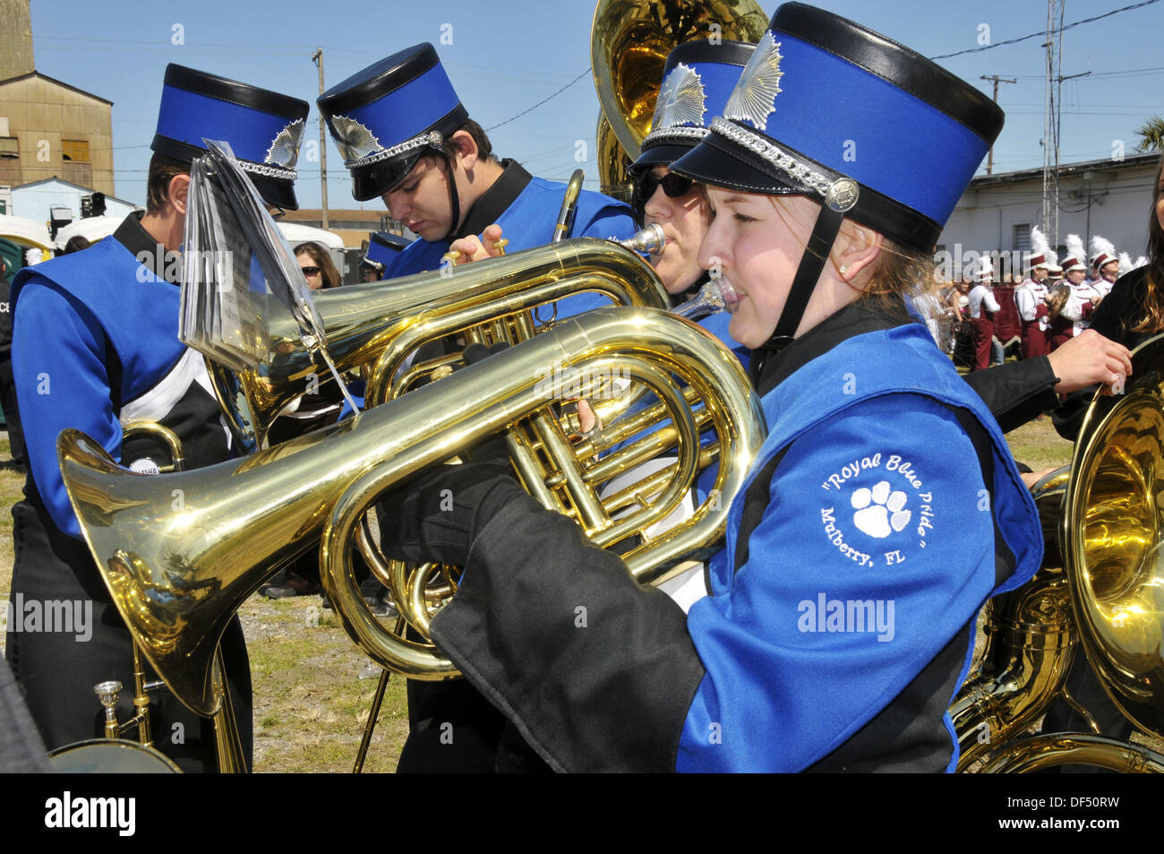 High school band member plays french horn at Strawberry Festival Parade, Plant City, Florida, USA - Stock Image