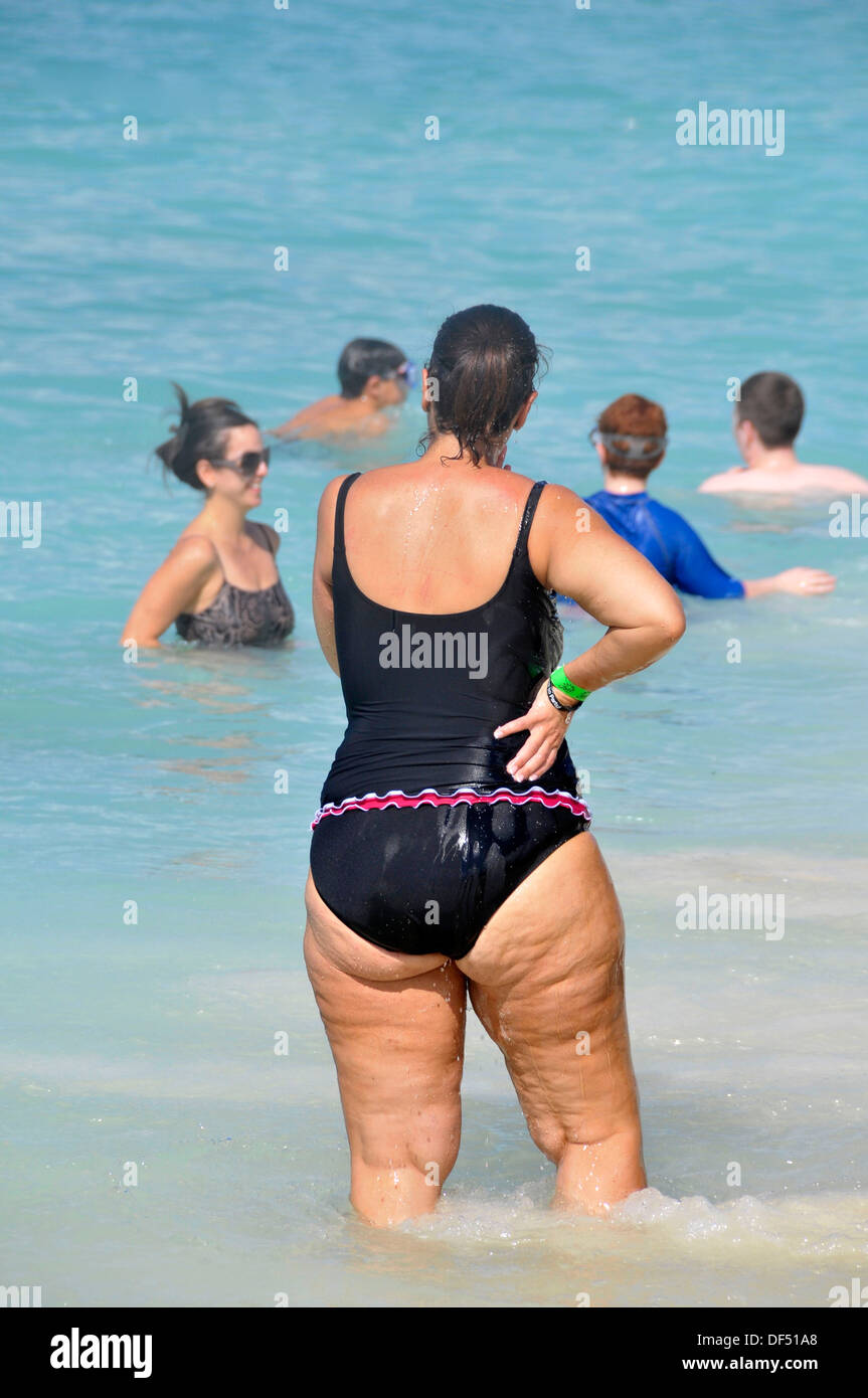 Overweight female at beach Grand Cayman Islands Caribbean - Stock Image