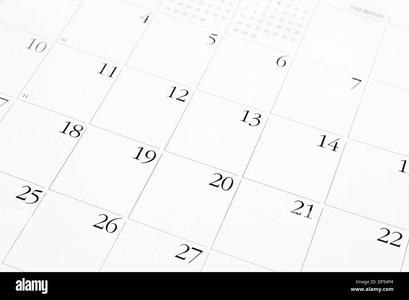 Closeup of dates on calendar page - Stock Image