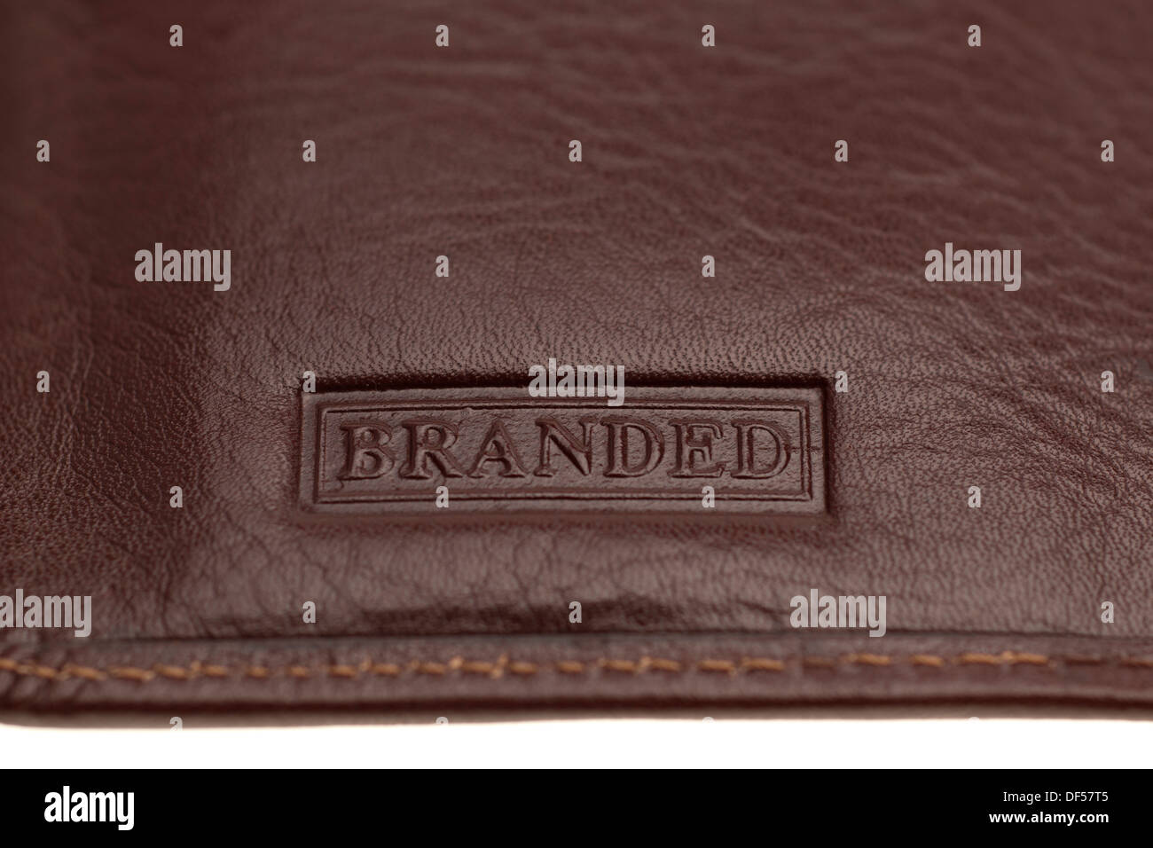 Closeup of a brown leather wallet with Branded - Stock Image