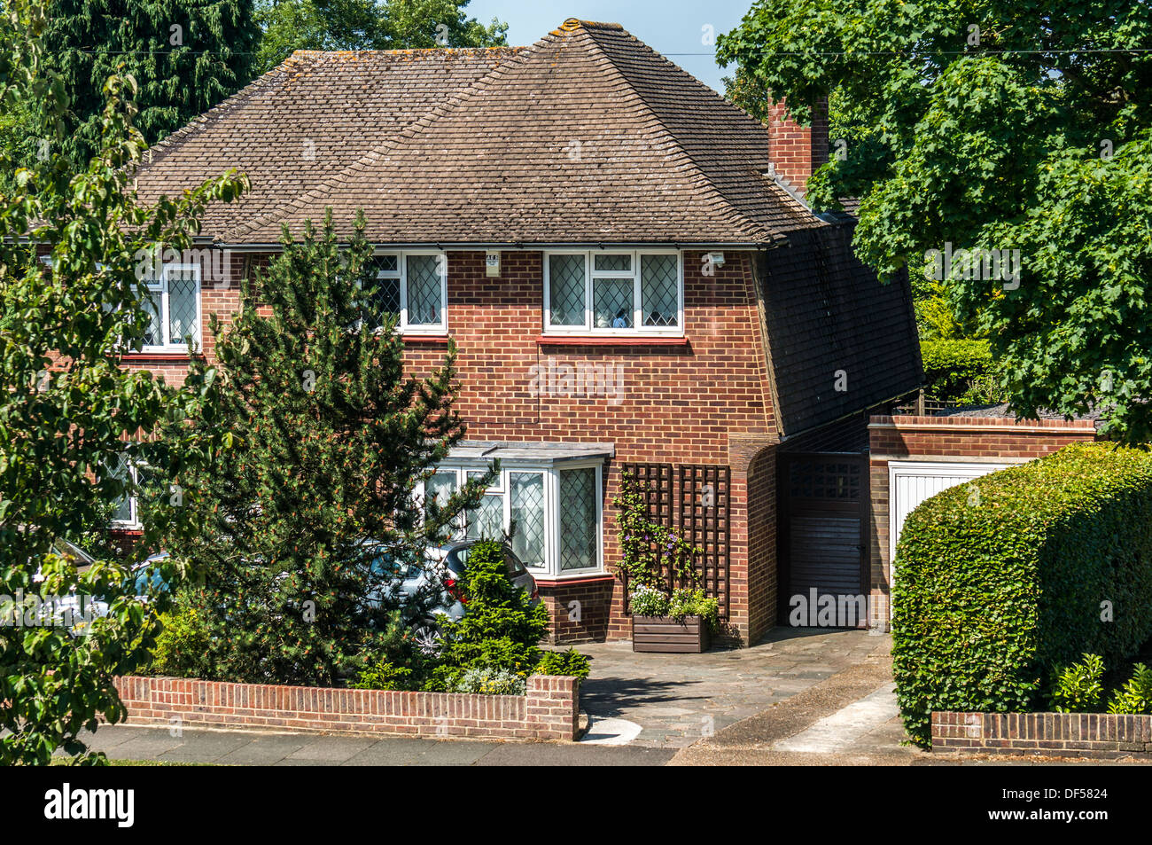 A period (1930s) detached house, typical of the area in Banstead, Surrey, UK. - Stock Image