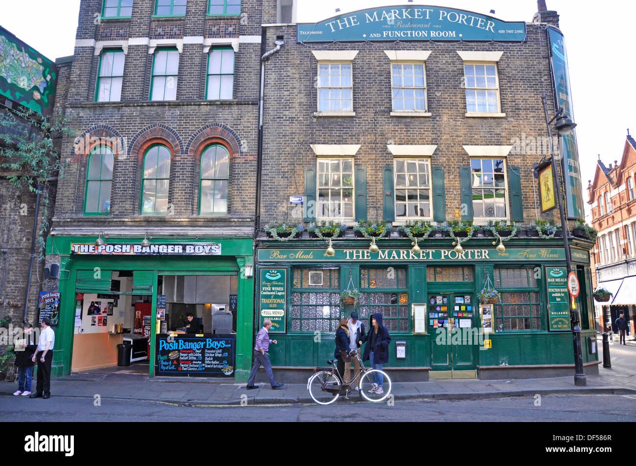 The Posh Banger Boys cafe and The Market Porter pub, directly opposite Borough Market (London's renowned food market). England, UK - Stock Image