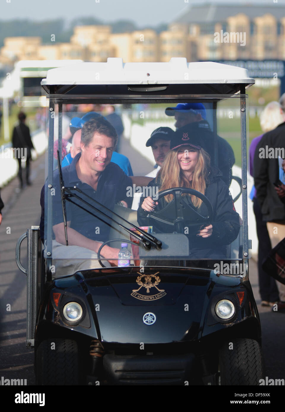 St Andrews, Scotland, UK, 28th September 2013, Hugh Grant is driven in buggie to play The Old Course St Andrews at The Dunhill Cup Credit:  Derek Allan/Alamy Live News - Stock Image