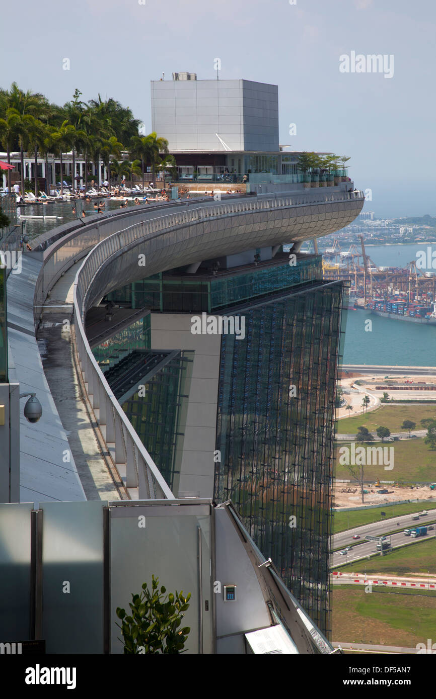 Marina Bay Sands Hotel roof pool Singapore Asia destination view above high top enjoy enjoyment guests swimming fun holidays - Stock Image