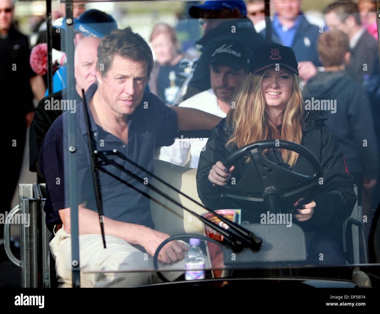 St Andrews, Scotland, UK, 28h September 2013, Hugh Grant is driven in buggie to play The Old Course St Andrews at The Dunhill Cup Credit:  Derek Allan/Alamy Live News - Stock Image