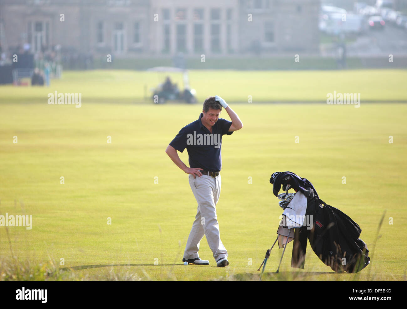 St Andrews, Scotland, UK, 28h September 2013, Hugh Grant plays down the 1st fairway at The Old Course St Andrews The Dunhill Cup 2013 Credit:  Derek Allan/Alamy Live News - Stock Image