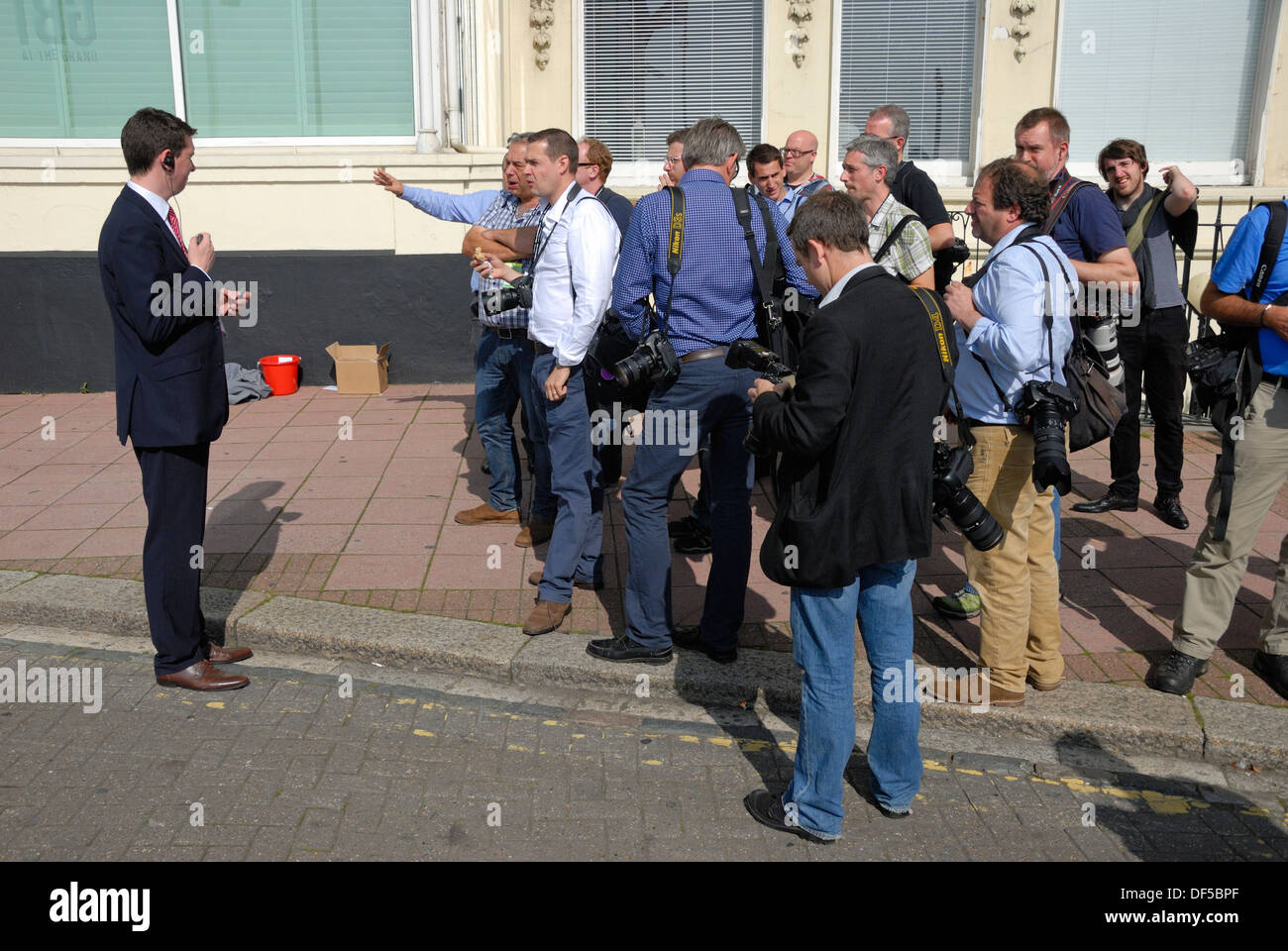 Photographers negotiating with security staff about where they can stand - Labour Party Conference, Brighton, 2013 - Stock Image
