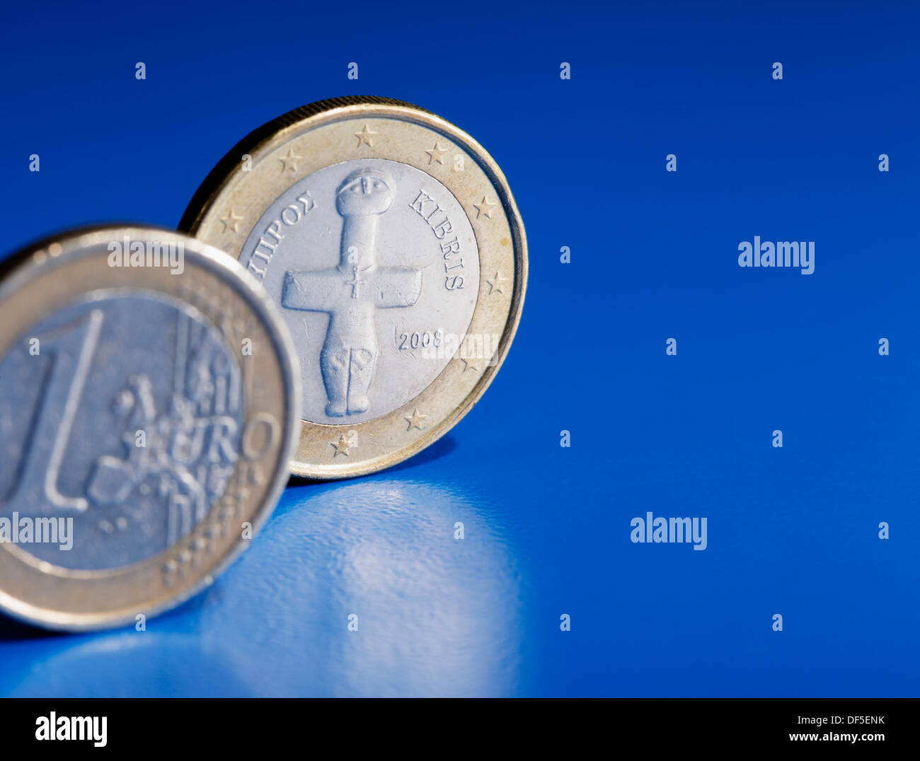 Euro coins from Cyprus on blue background. - Stock Image