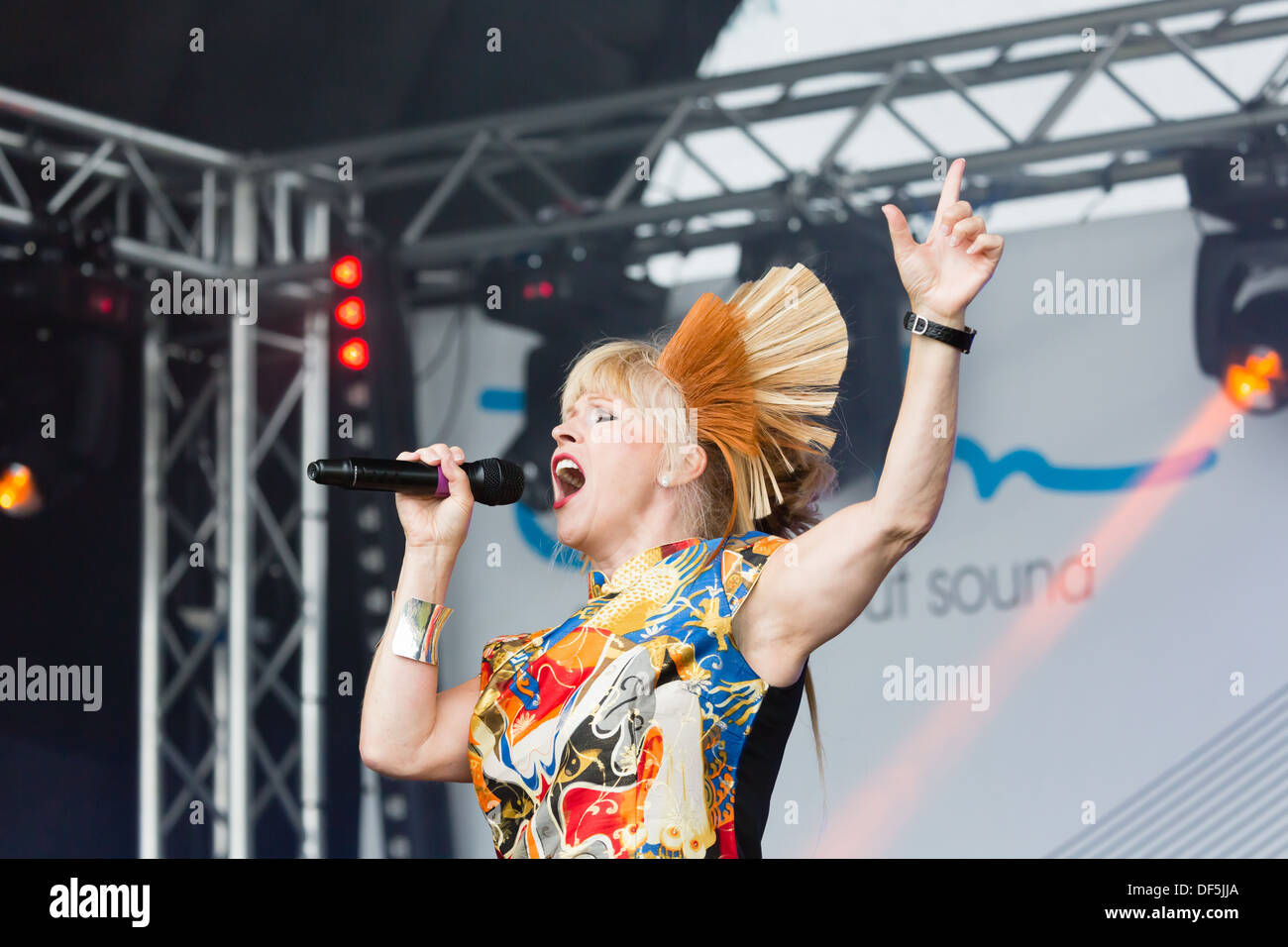 Toyah Wilcox with one hand in the air, singing at the Newcastle Pride event, July 2013 in Newcastle on Tyne. - Stock Image