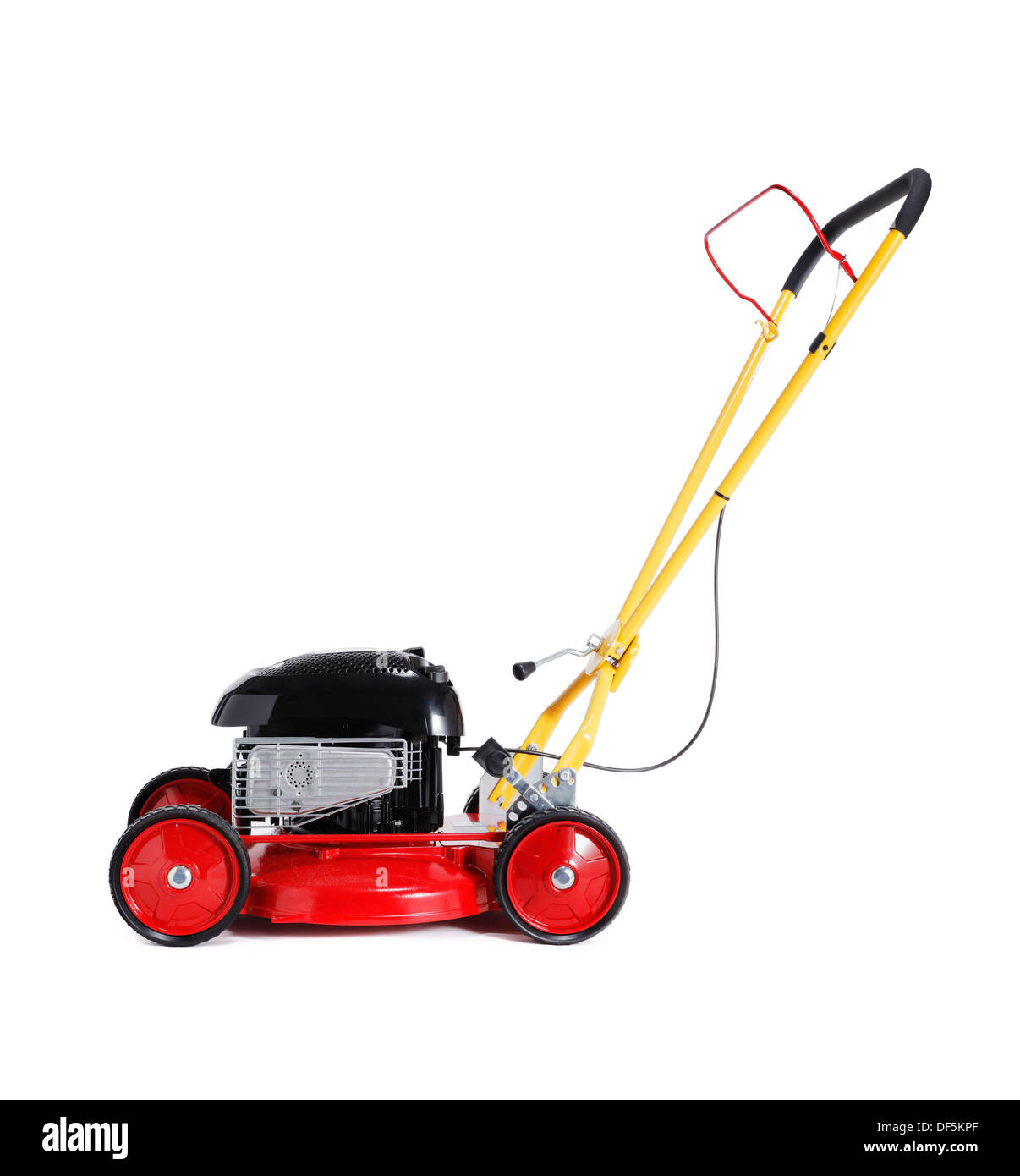 Red new retro-styled lawn mower isolated on white with natural shadow. - Stock Image