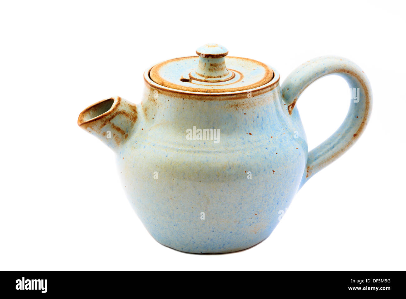 Small ceramic pottery teapot (tea pot) cut out and isolated on a white background. England UK Britain - Stock Image