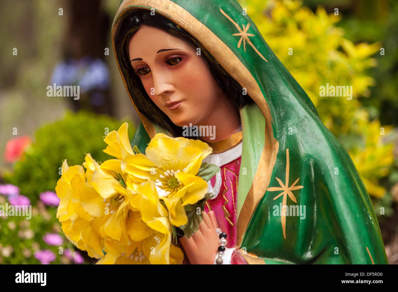 Colorful statue of the Virgin Mary in Mexico City - Stock Image