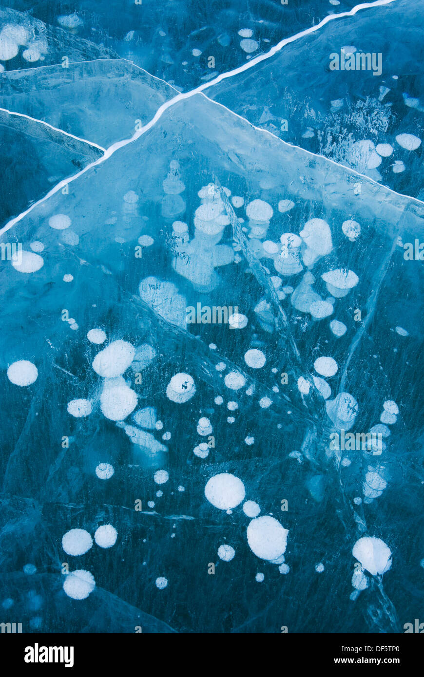 Abstract patterns in the wind polished ice of Abraham Lake, Alberta Canada - Stock Image
