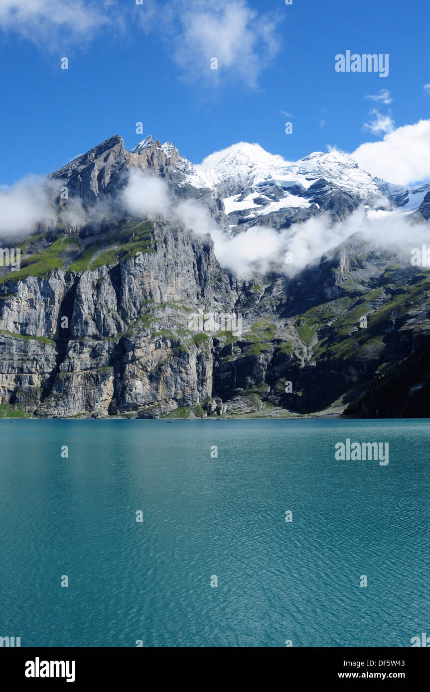 Oeschinensee Lake and Bluemlisalp range of mountains in the Bernese Oberland above Kandersteg, Switzerland, Europe - Stock Image