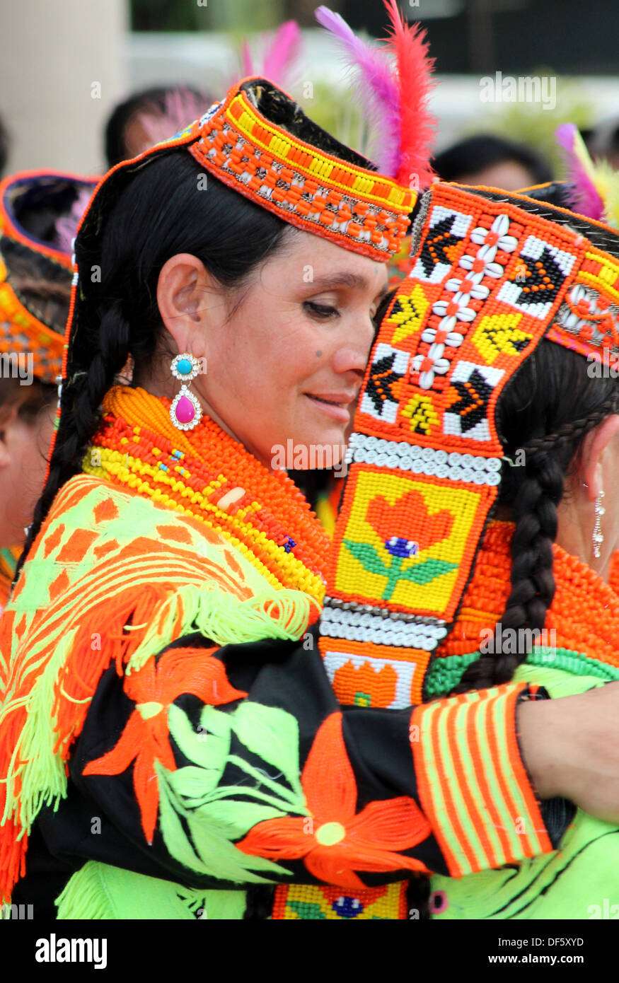Karachi, Pakistan. 27 Sept 2013. Kalash women from Chitral Pakistan perform a dance at the largest trade fair in Pakistan. © Aine Moorad/Alamy Live News - Stock Image