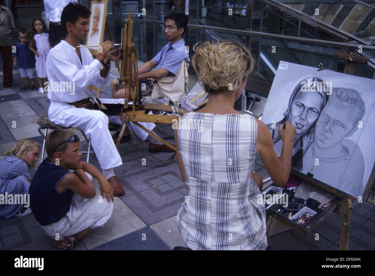 Drawing caricatures in Major Square. Palma de Mallorca. Balearic Islands. Spain - Stock Image