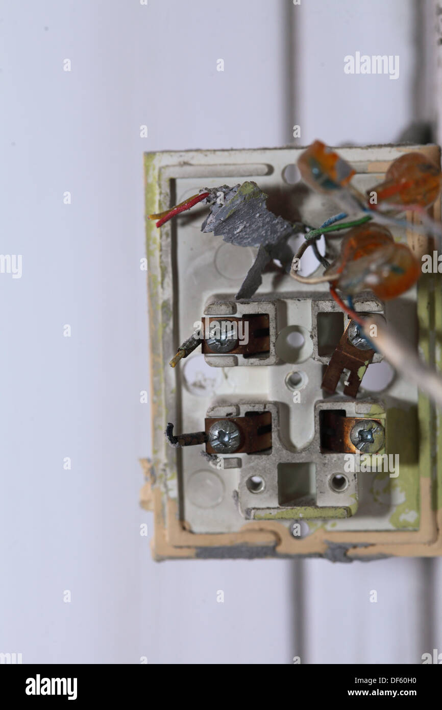 Close up installing a power socket. Opened light switch with Stock ...