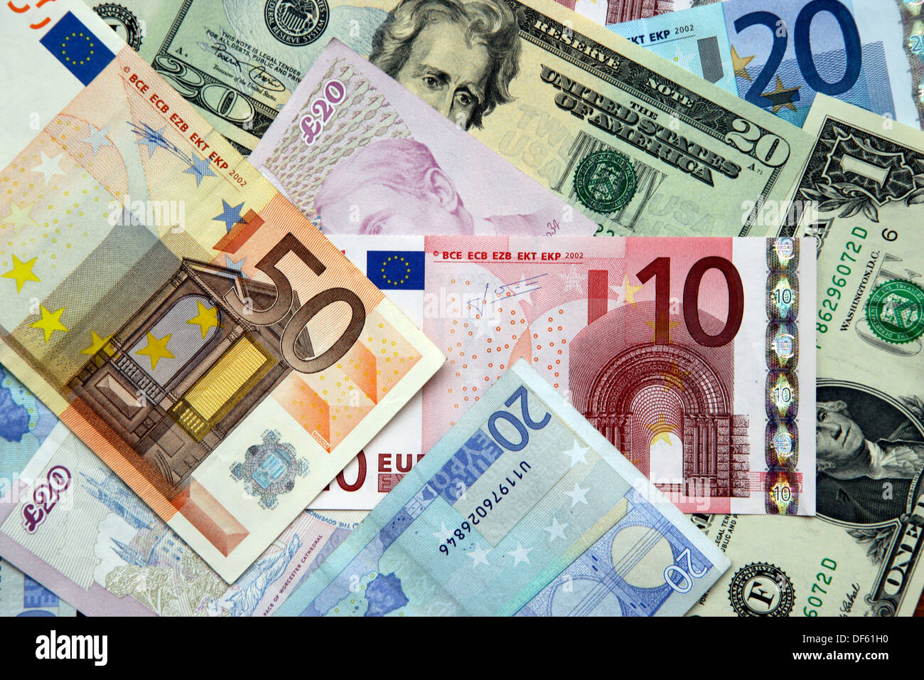 Dollars, Pounds Sterling and Euros - Stock Image