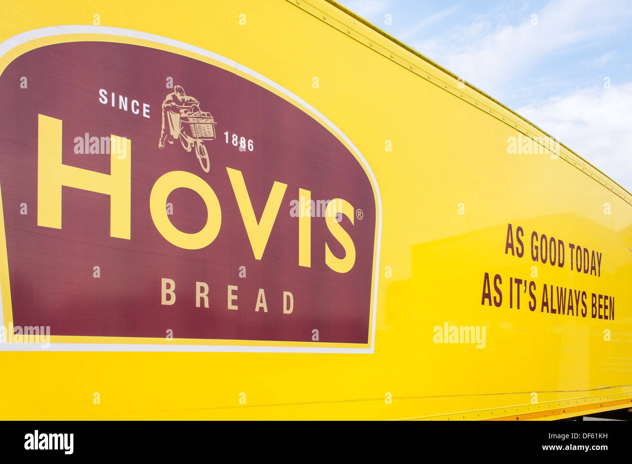 Side of HGV delivery lorry with Hovis company branding: logo, slogan, colours - Stock Image
