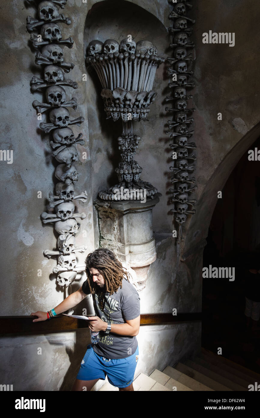 Young tourist at Sedlec Ossuary, Kutna Hora, Czech Republic - Stock Image