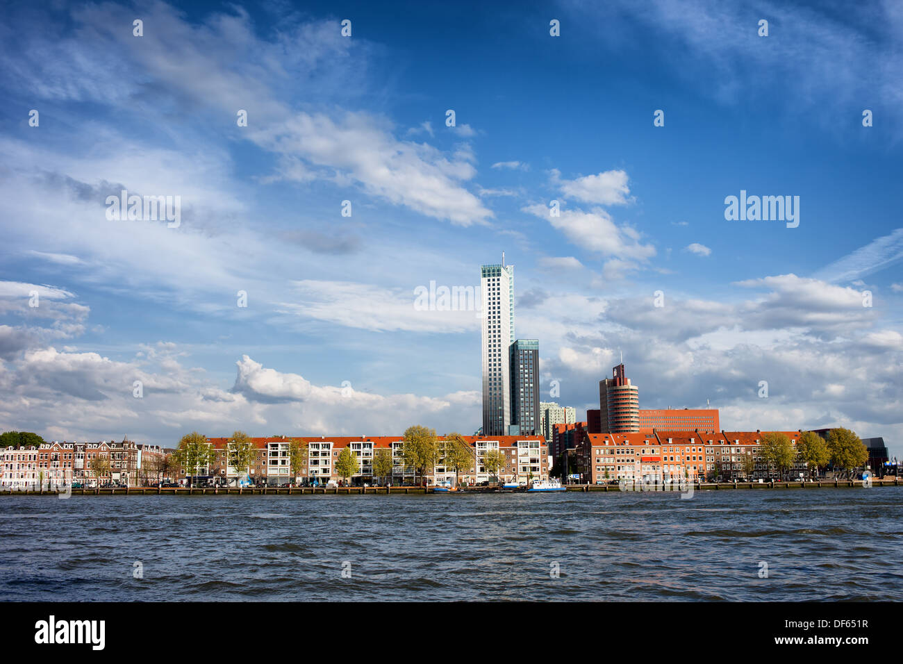 Terraced houses skyline along New Meuse (Dutch: Nieuwe Maas) river in Rotterdam city centre, Netherlands. Stock Photo