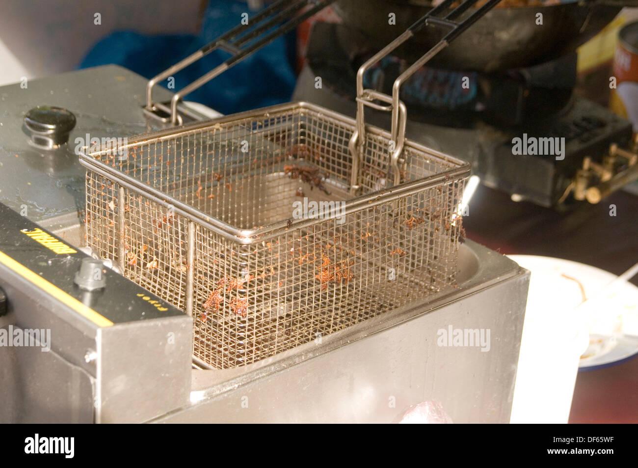 deep fried food fast fry vat basket foods chip chips baskets oil fat fryer fryers fryalator frialator flying in Stock Photo