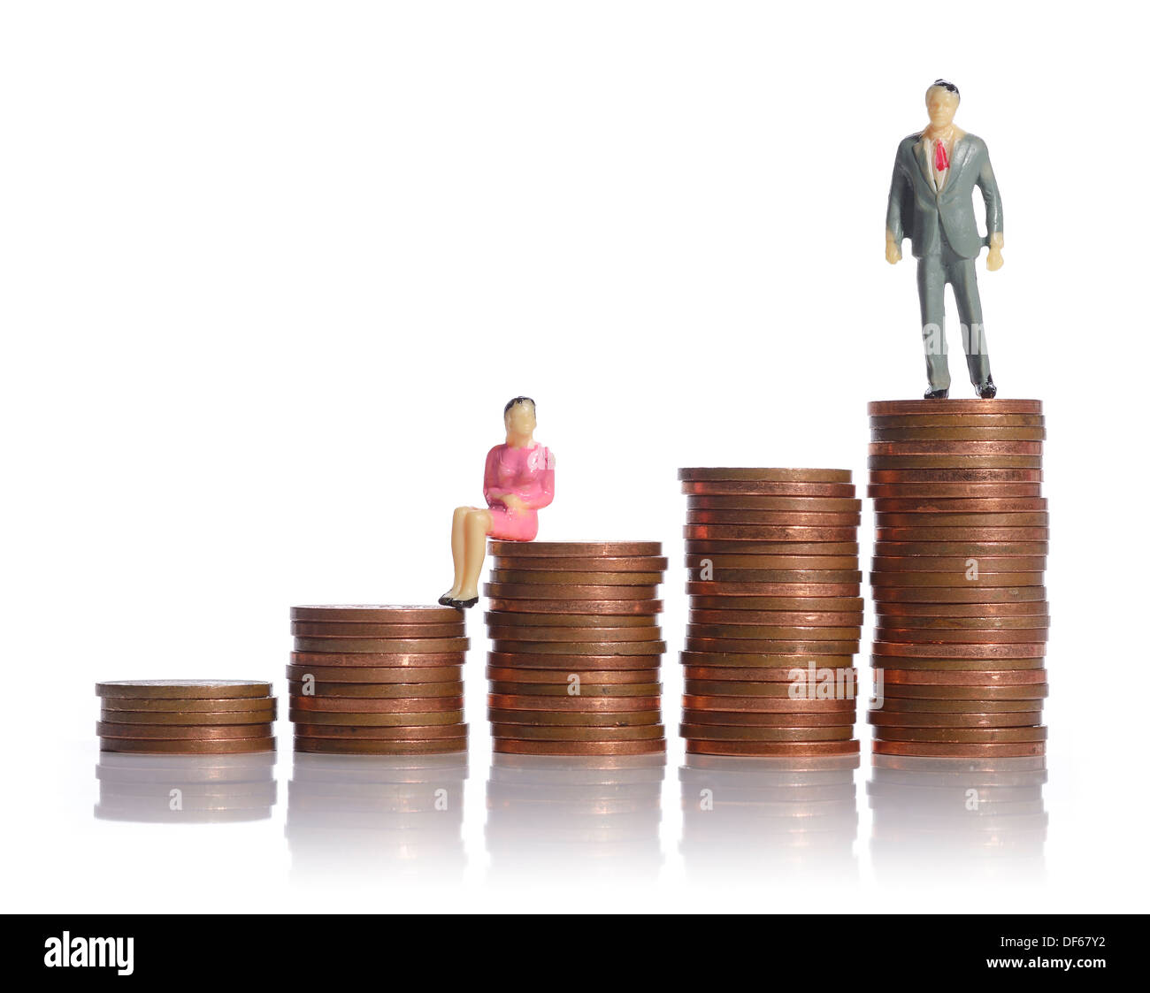 Mini plastic man and a woman sitting on piles of cash Stock Photo