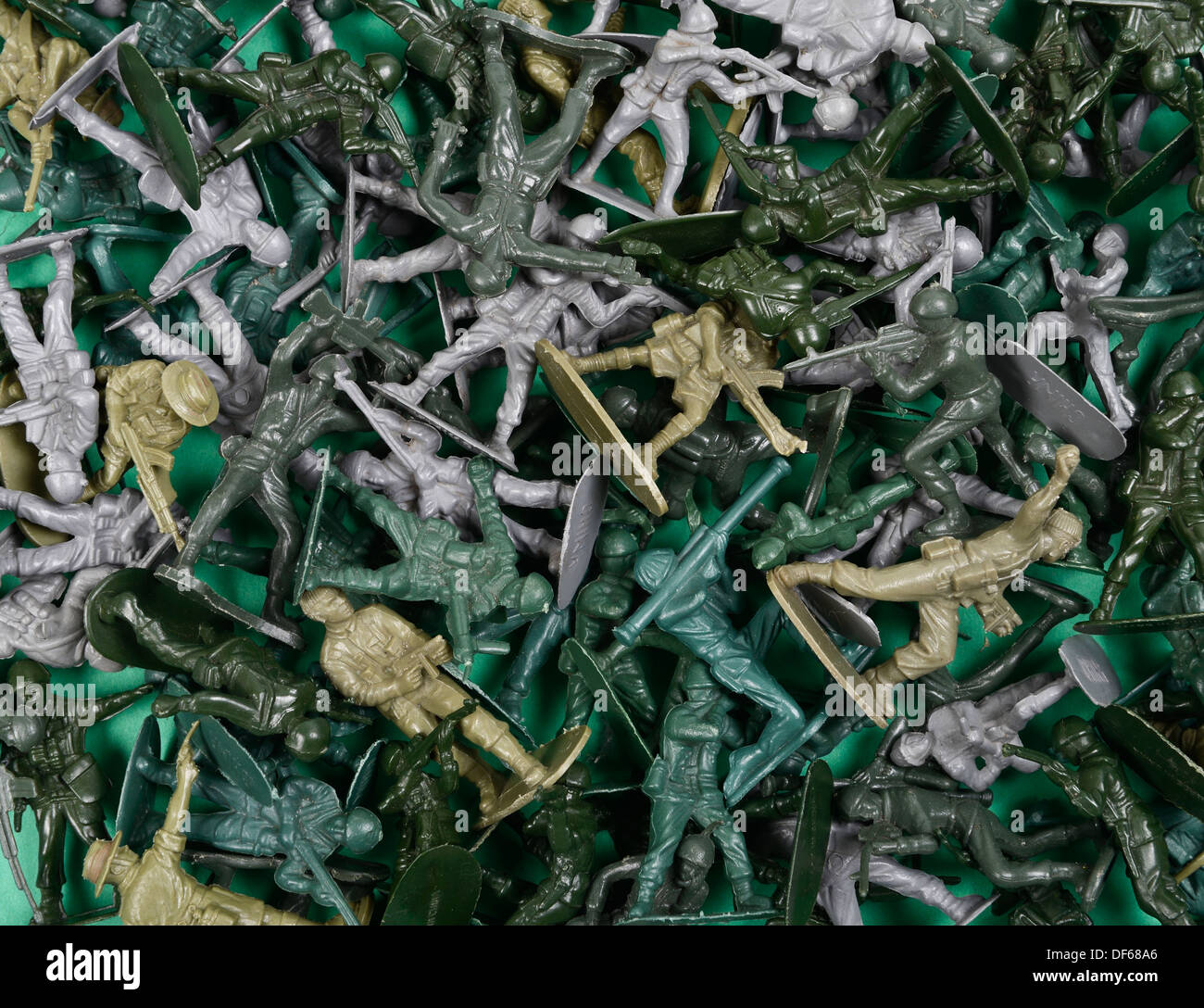 Jumble of green plastic toy soldiers - Stock Image