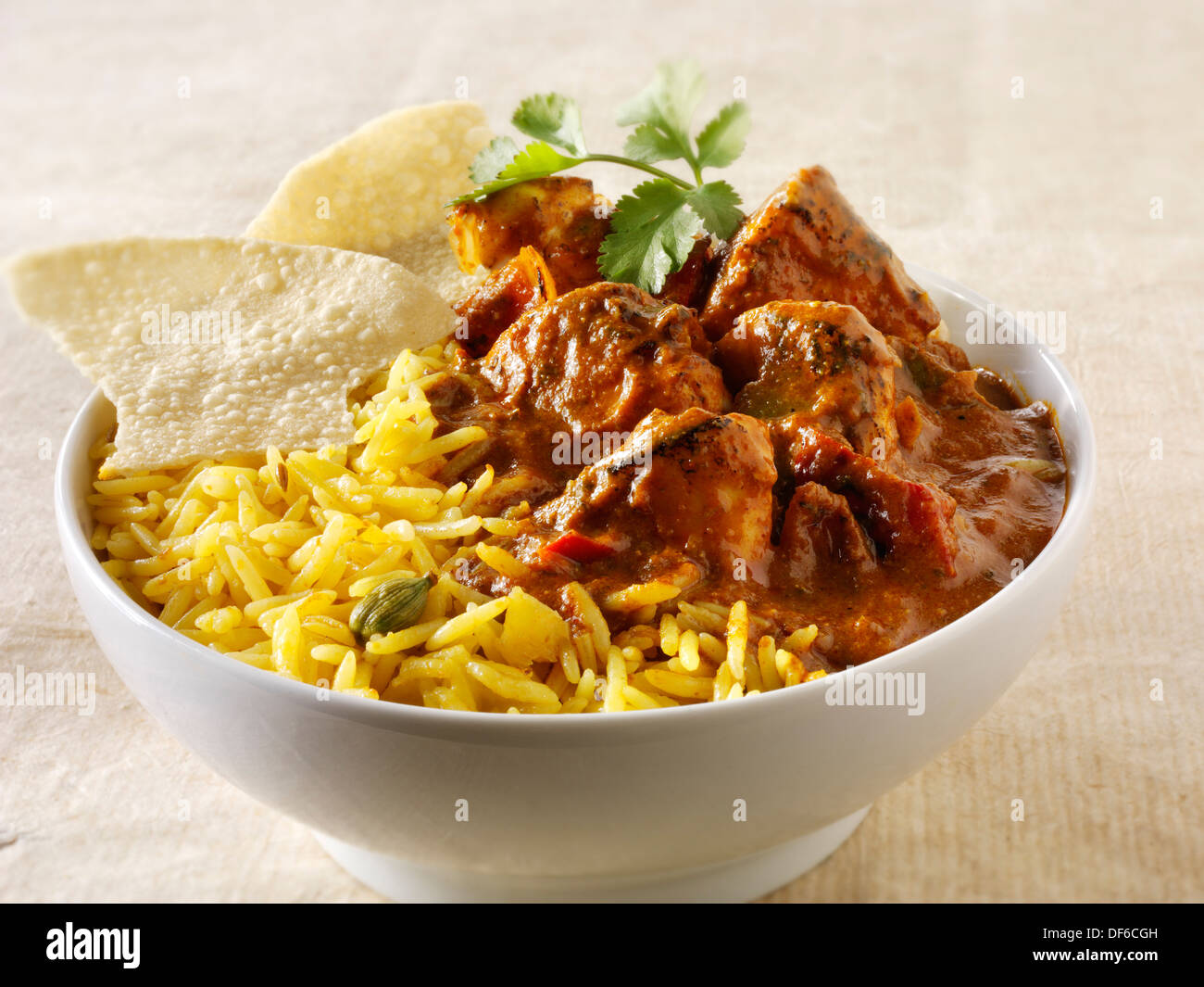 Chicken Jalfrezi, pilau rice & popodoms. Indian traditional curry. - Stock Image