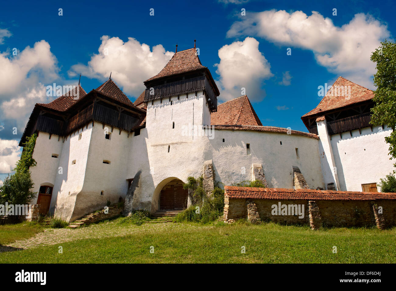 Front view of the Szekly medieval fortified church of Viscri, BunesŸti, Brasov, Transylvania. Started in the 1100's. UNESCO Worl - Stock Image