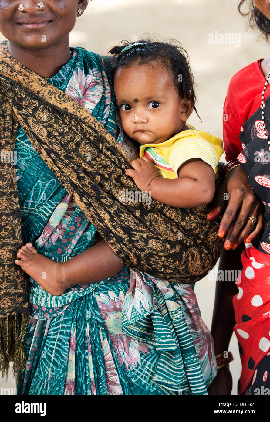 Rural Indian baby in mothers sling. Andhra Pradesh, India - Stock Image