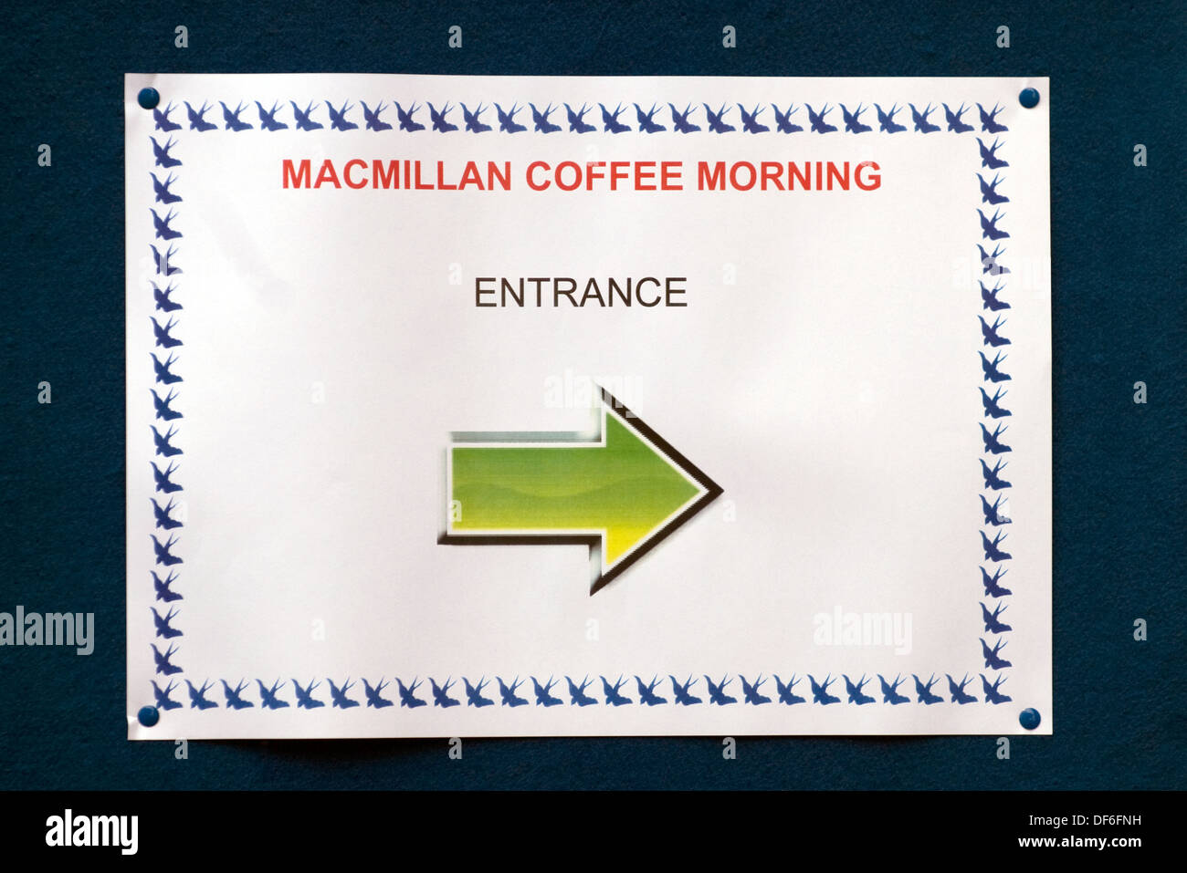 Sign pointing the way to a Macmillan Cancer Support Coffee Morning, Farnham, Surrey, UK. Stock Photo