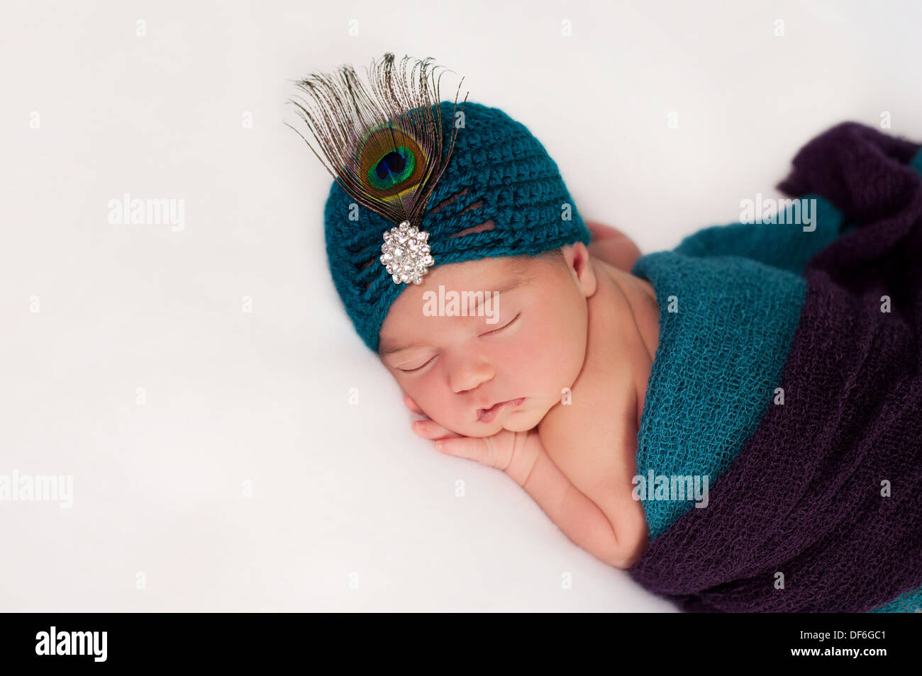 Newborn Baby Girl Wearing a Peacock Costume - Stock Image