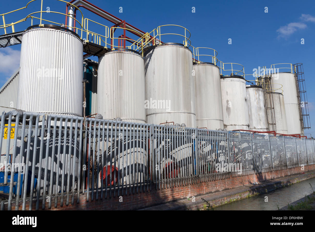 Storage tankers within a chemical works UK - Stock Image
