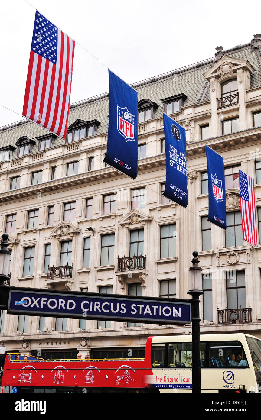 Flags and banners hanging above Oxford Circus underground station during the NFL block party on 28th September 2013 - Stock Image