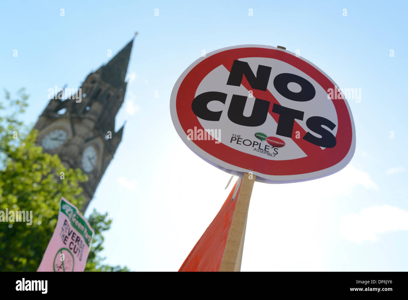 Manchester, UK. 29th Sept 2013. A sign reading 'No Cuts' in Albert Square during a North West TUC organised march and rally intending to defend National Health Service (NHS) jobs and services from cuts and privatisation. The march coincides with the Conservative Party Conference 2013 being held in the city. Credit:  Russell Hart/Alamy Live News. - Stock Image