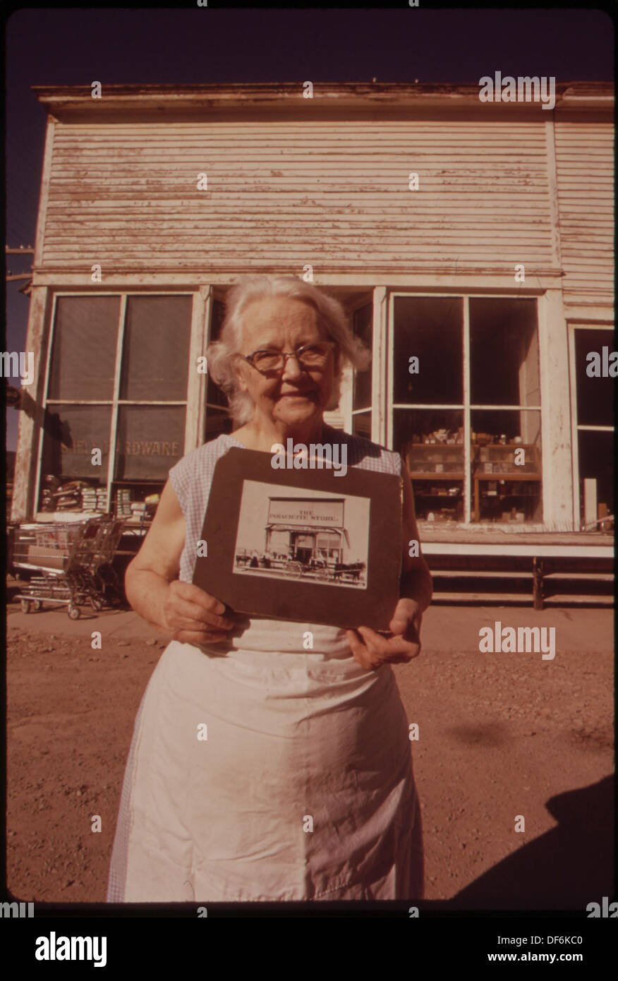 MRS. ALBERS AND HER HUSBAND RUN THE ONE REMAINING STORE IN GRAND VALLEY. AS IT BECAME UNPROFITABLE TO OWN AND OPERATE... 552680 - Stock Image