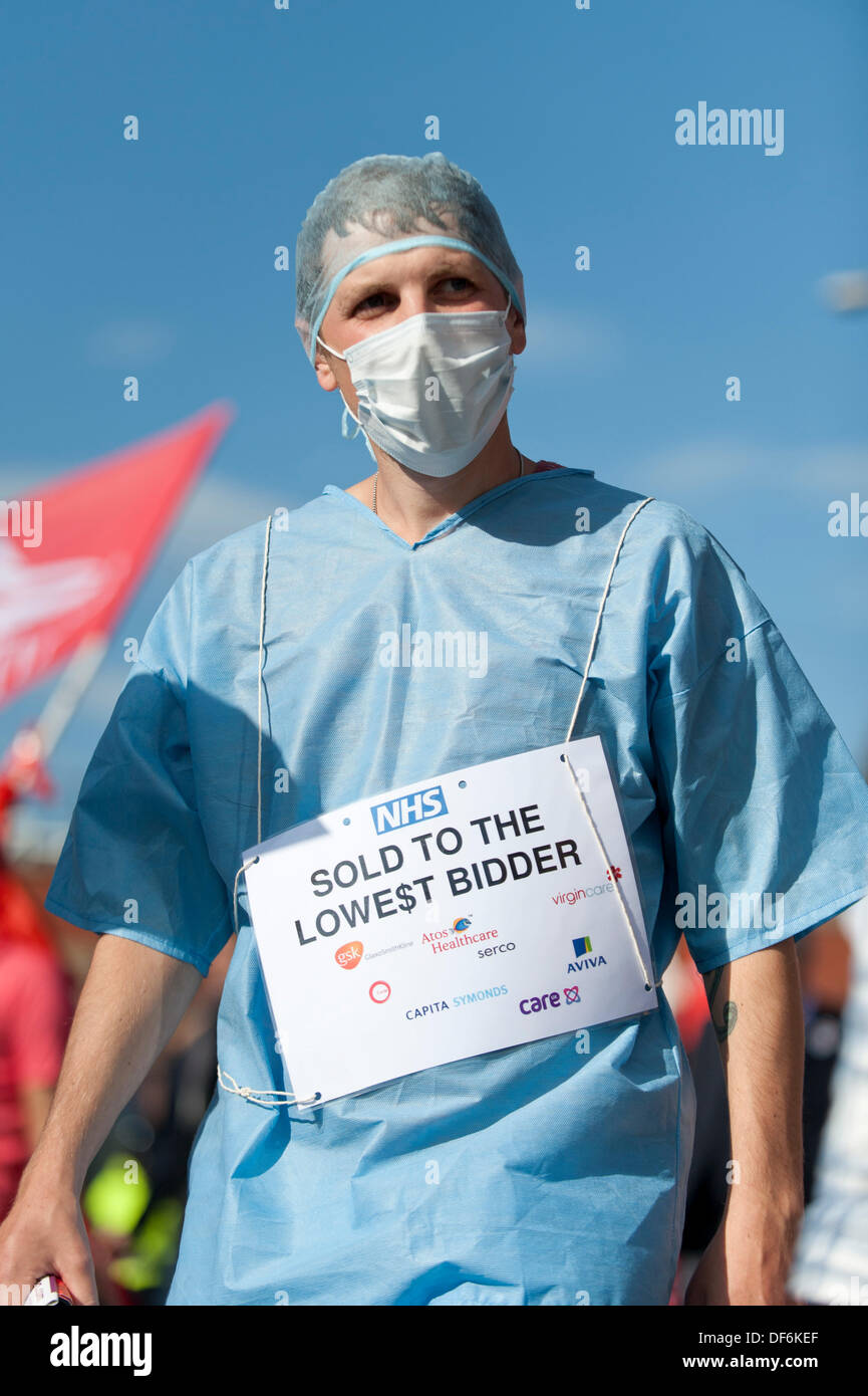 Manchester, UK. 29th Sept 2013. A male protester wearing a surgeon's uniform during a North West TUC organised march and rally intending to defend National Health Service (NHS) jobs and services from cuts and privatisation. The march coincides with the Conservative Party Conference 2013 being held in the city. Credit:  Russell Hart/Alamy Live News. - Stock Image
