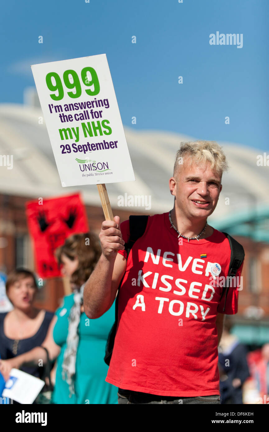 Manchester, UK. 29th Sept 2013. A male protester wearing a 'Never Kissed a Tory' t-shirt during a North West TUC organised march and rally intending to defend National Health Service (NHS) jobs and services from cuts and privatisation. The march coincides with the Conservative Party Conference 2013 being held in the city. Credit:  Russell Hart/Alamy Live News. - Stock Image