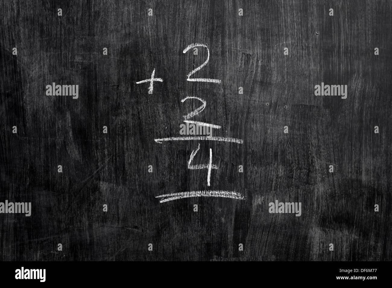 Simple math equation written with chalk on blackboard Stock Photo ...