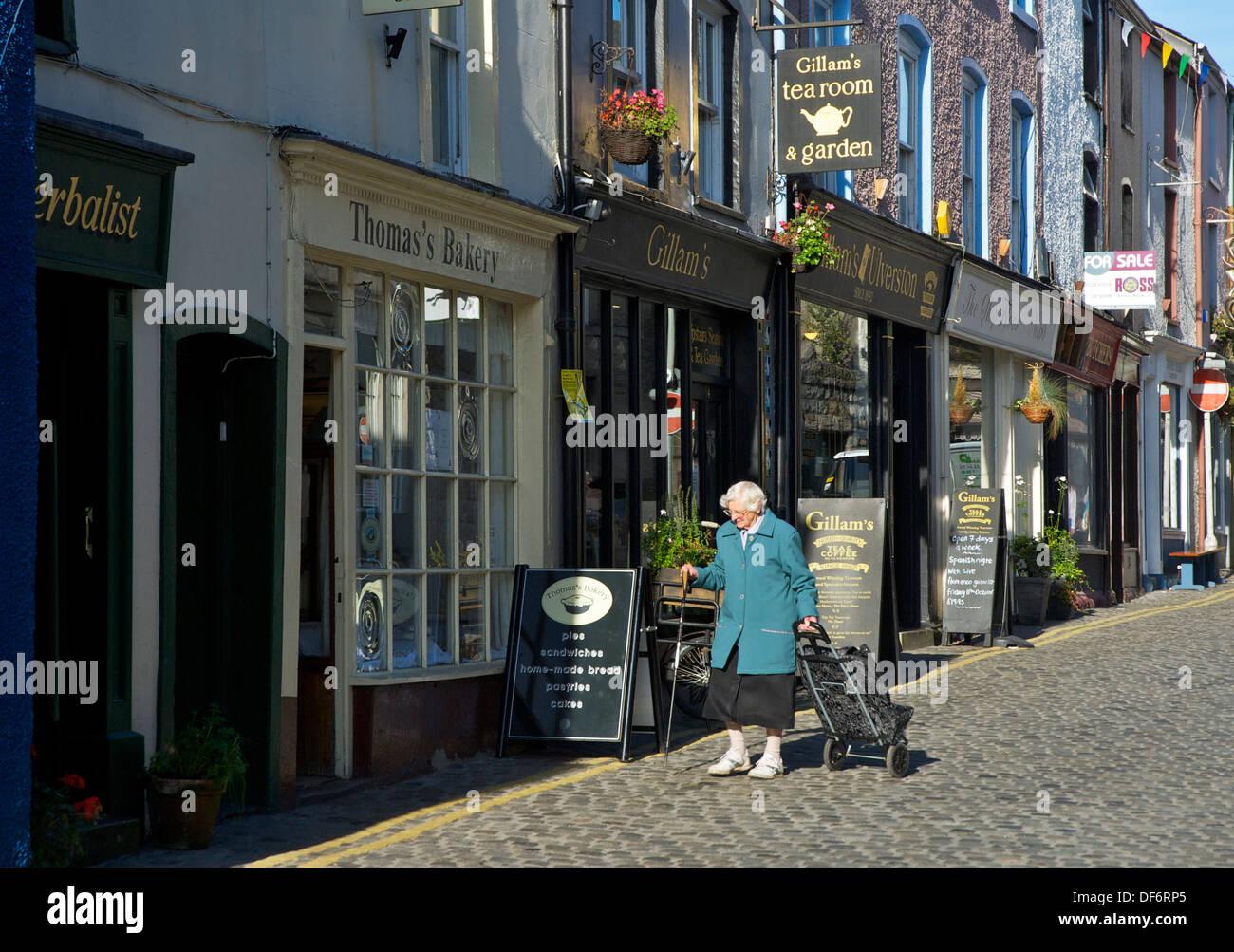 Old lady on Market Street, Ulverston, Cumbria, England UK - Stock Image