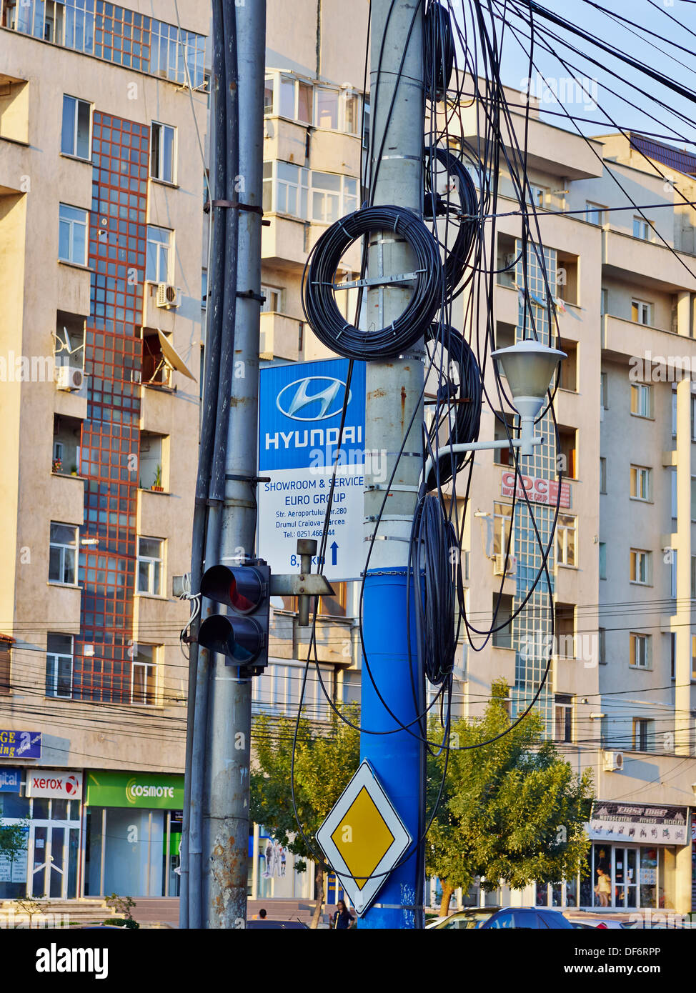 Chaotic telecommunication cabling on a street pool in Craiova, Romania. - Stock Image