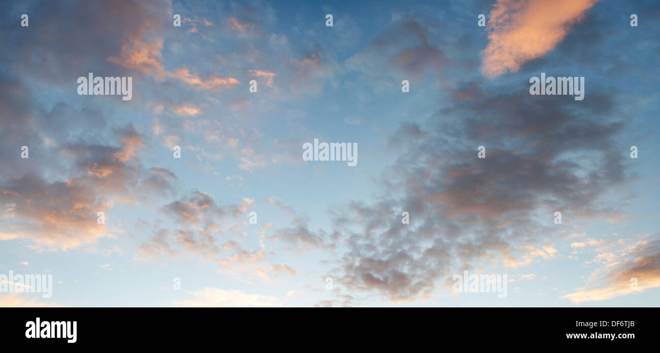 Fluffy clouds in blue sky - Stock Image