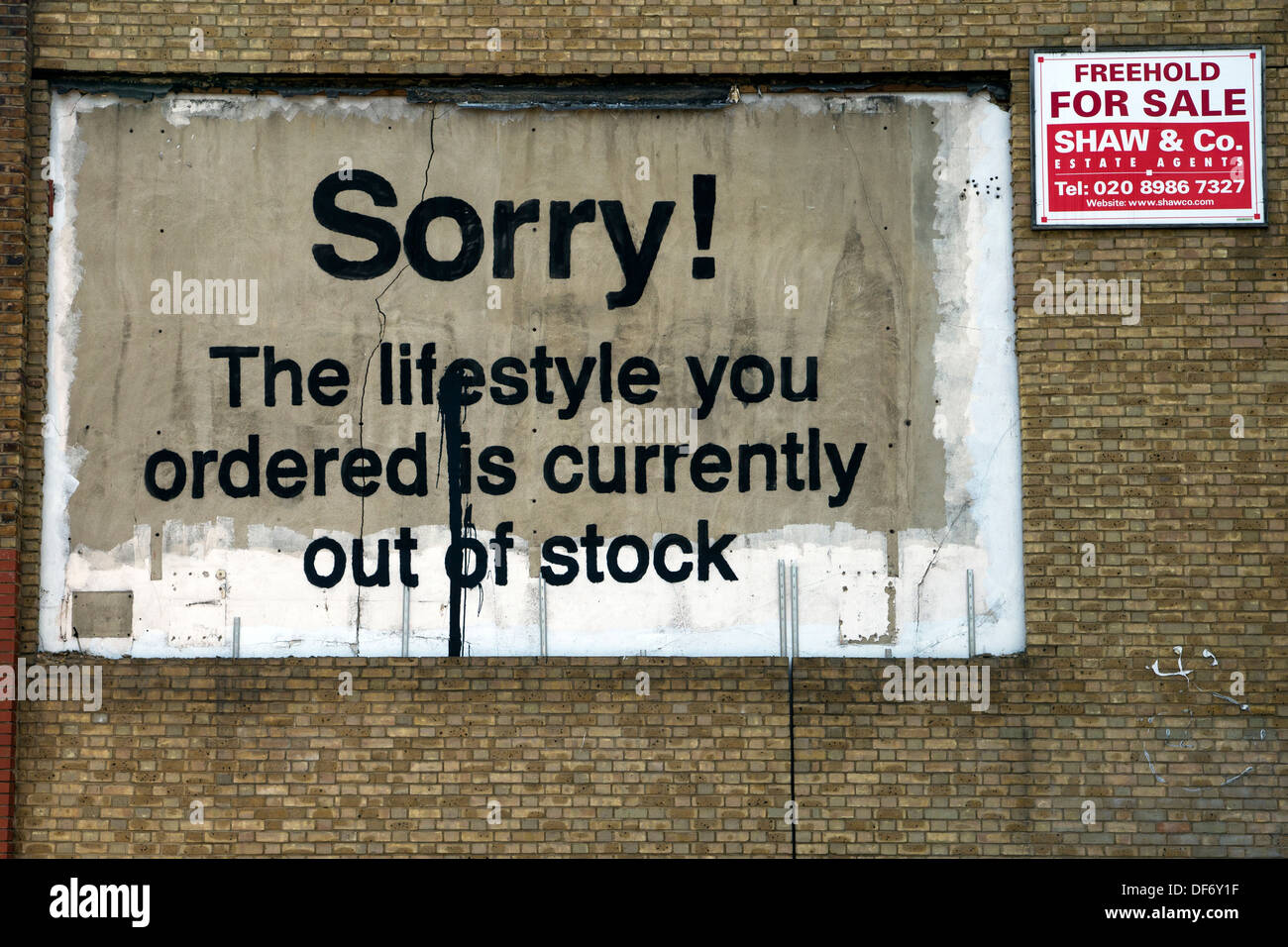 'Sorry the lifestyle that you have ordered is out of stock' street art by Banksy, East India Dock Road, London, UK. - Stock Image