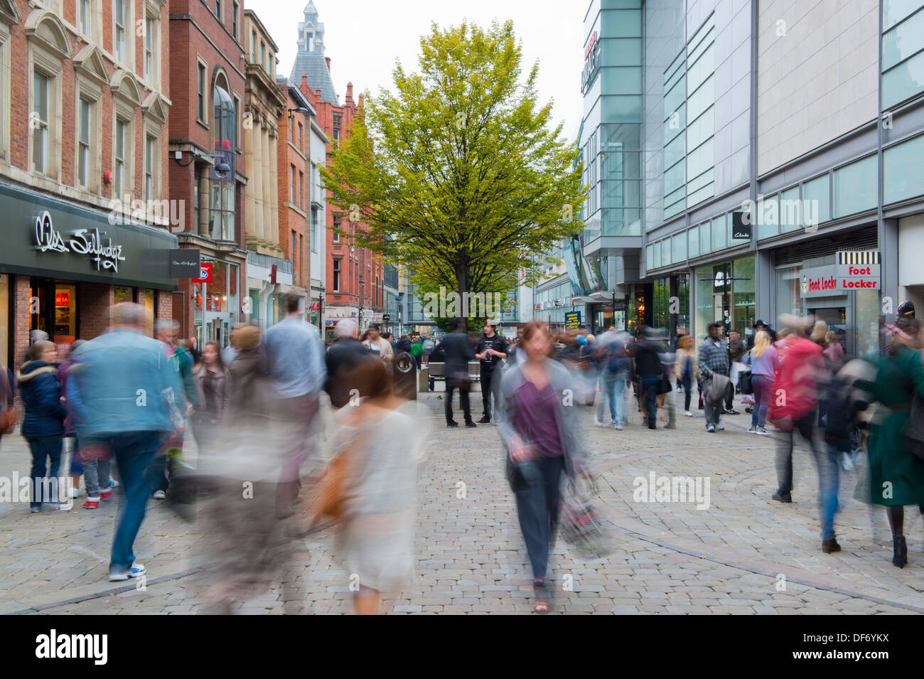 A general view of a busy Market Street, located in the central shopping area of Manchester. - Stock Image