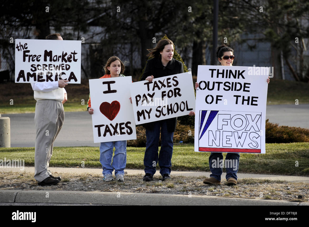 Ordinary citizen protestors protest taxes and other government wasteful spending - Stock Image
