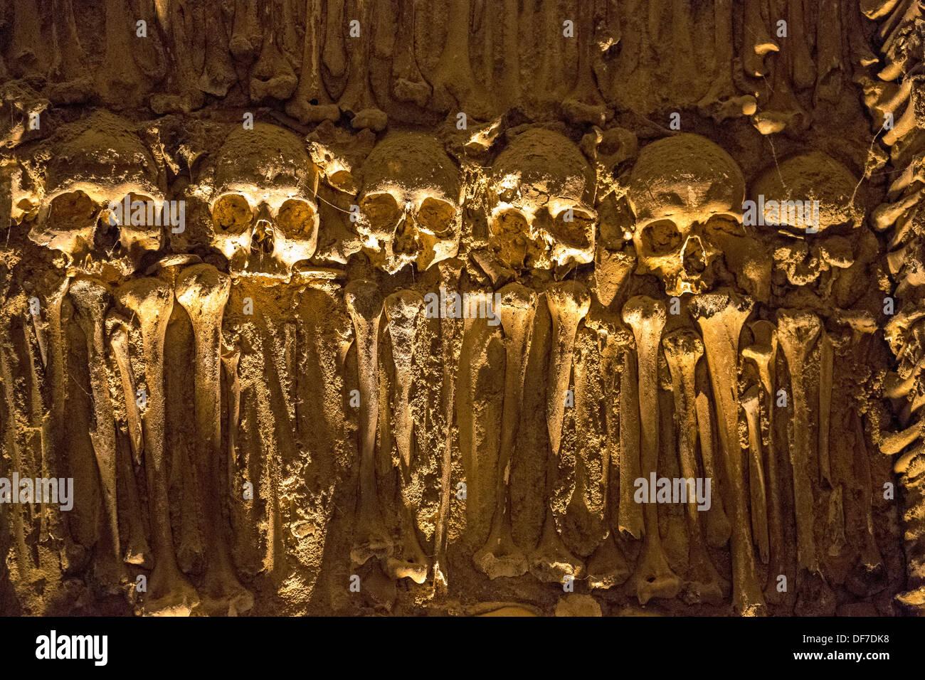 Skulls and bones in the ossuary, Capela dos ossos parede, chapel of the bones, bones chapel, Évora, Évora District, Portugal - Stock Image