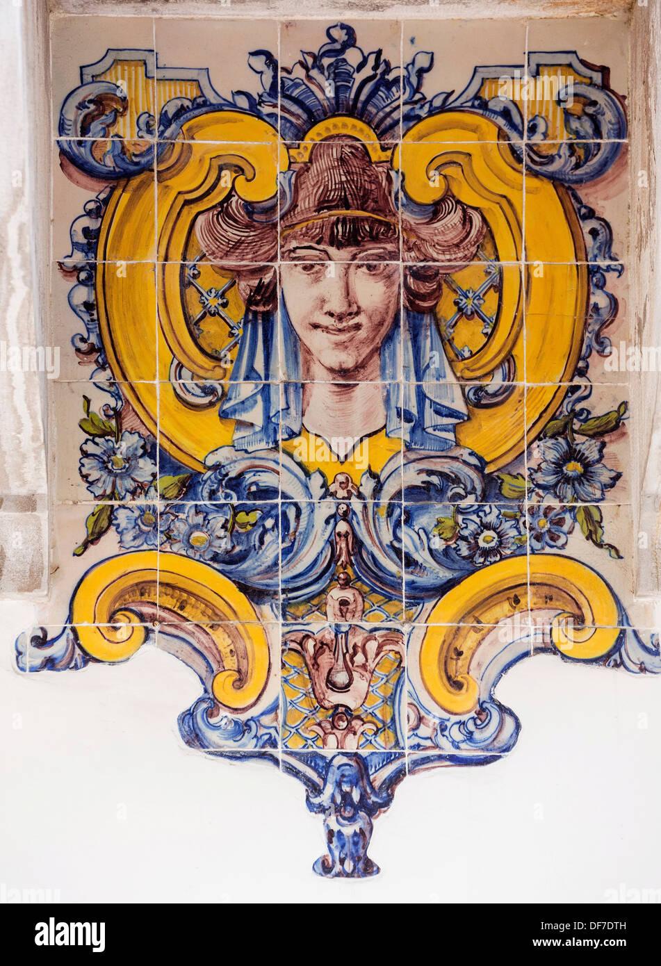 Painted Azulejos tiles, Art Nouveau style, woman's head, Sintra, Lisbon District, Portugal - Stock Image